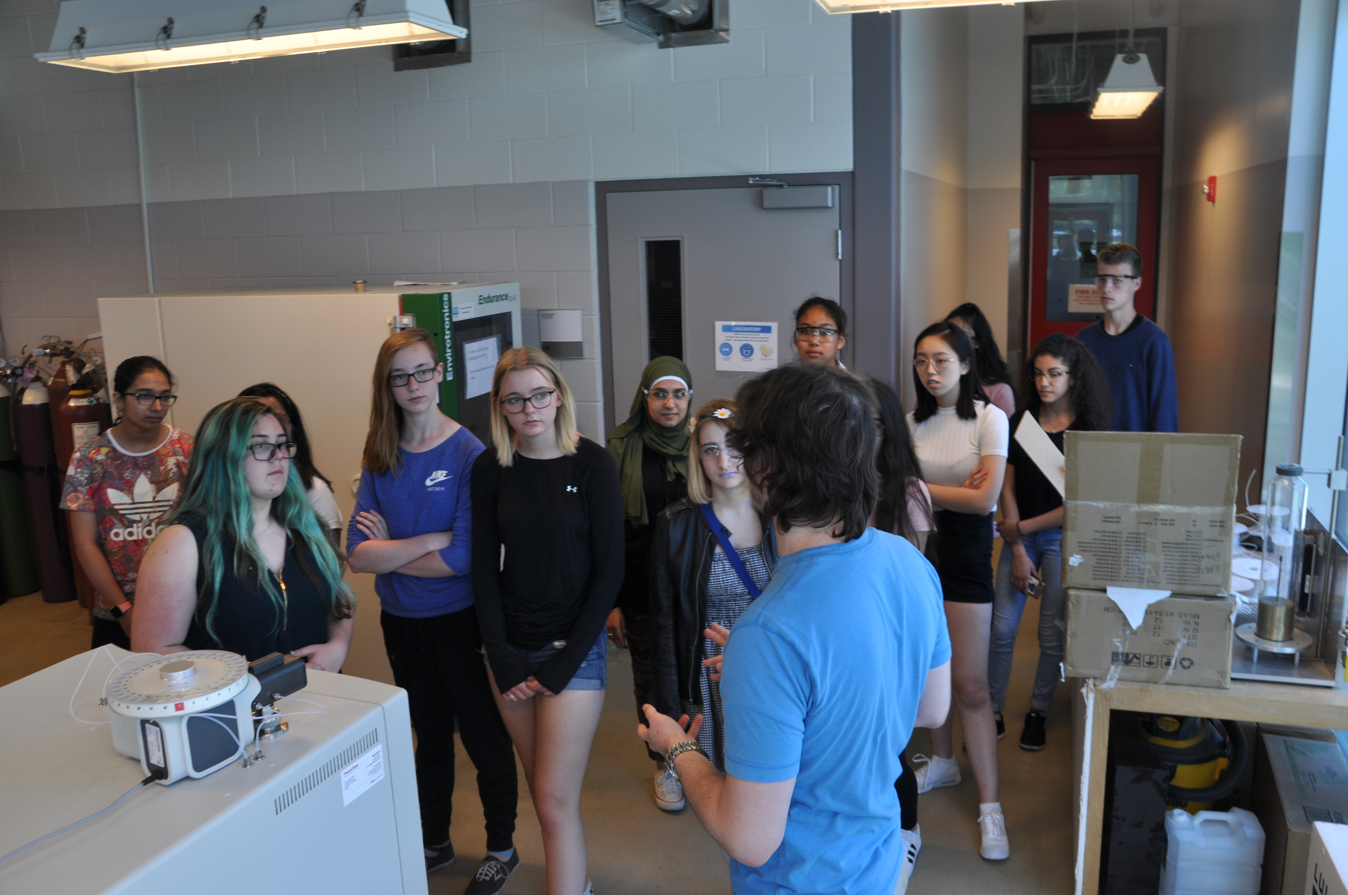 Michael Snowdon leading a group of high school students through the Bioproducts Facility
