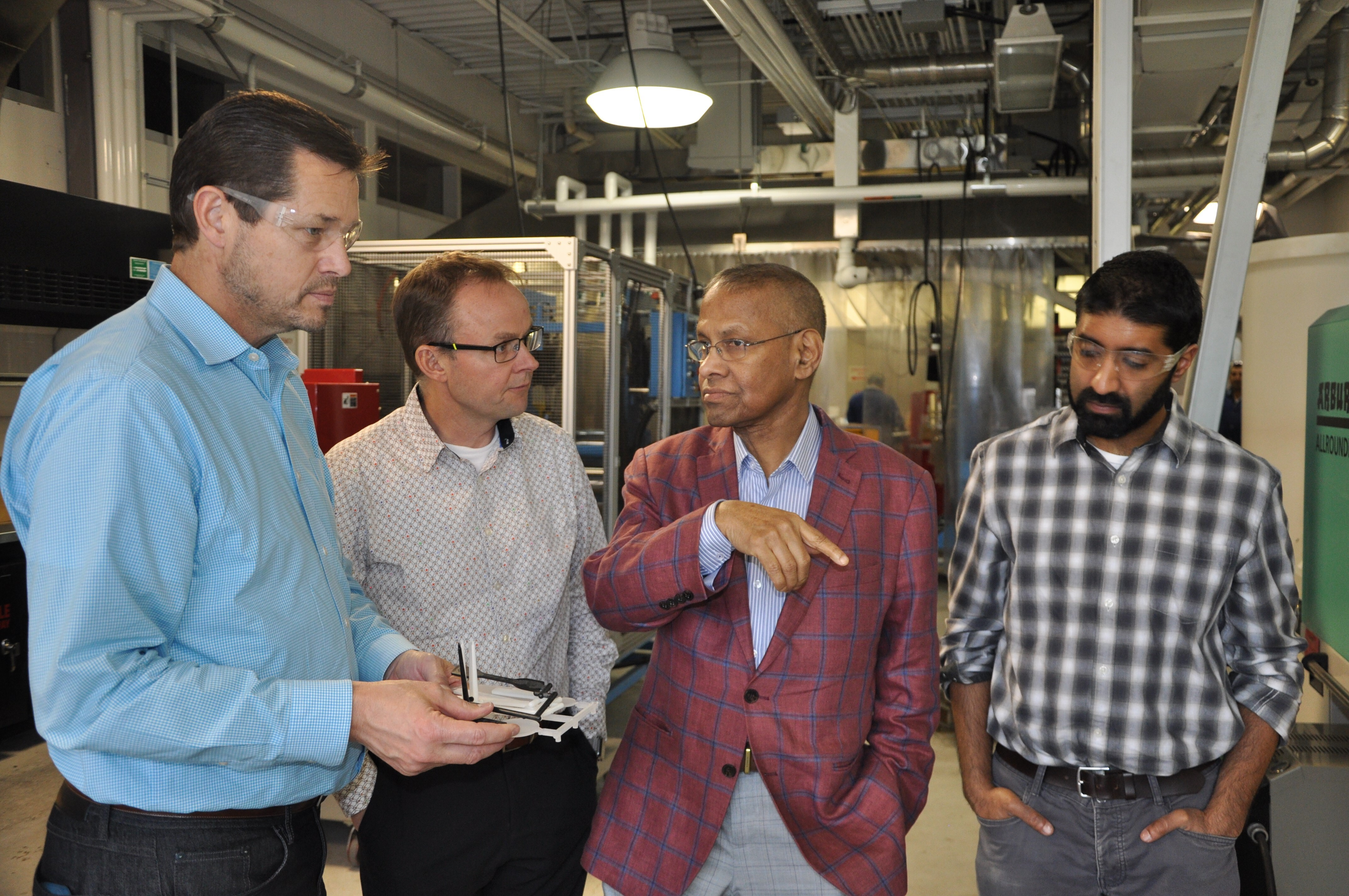 Image - Prof. Amar Mohanty giving a tour of the BDDC to representatives from Ecosynthetix