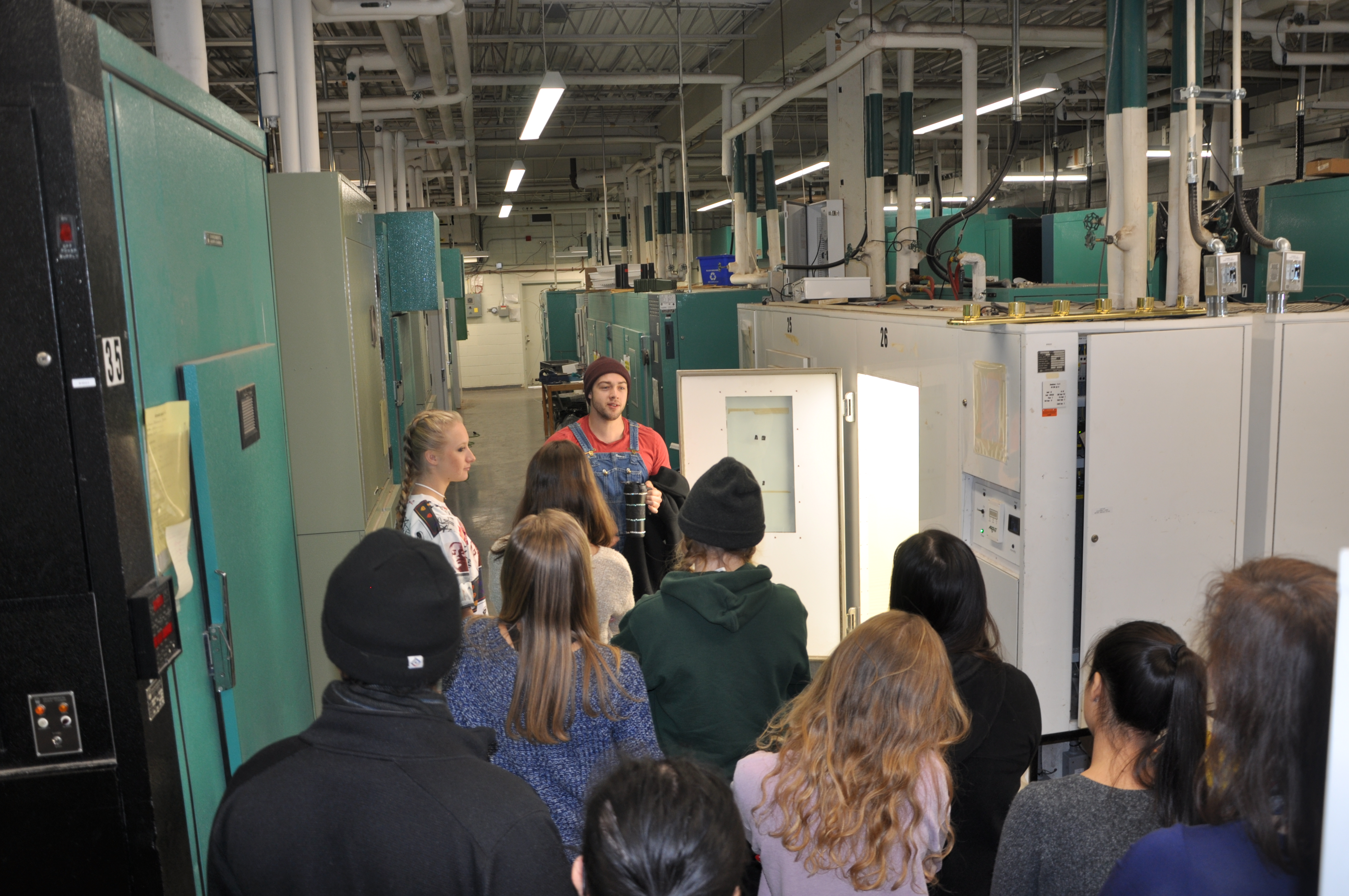 Group of high school students being given a tour of the growth facilities by Austin.