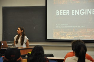 Alexis Wagner giving a guest lecture to undergraduate students