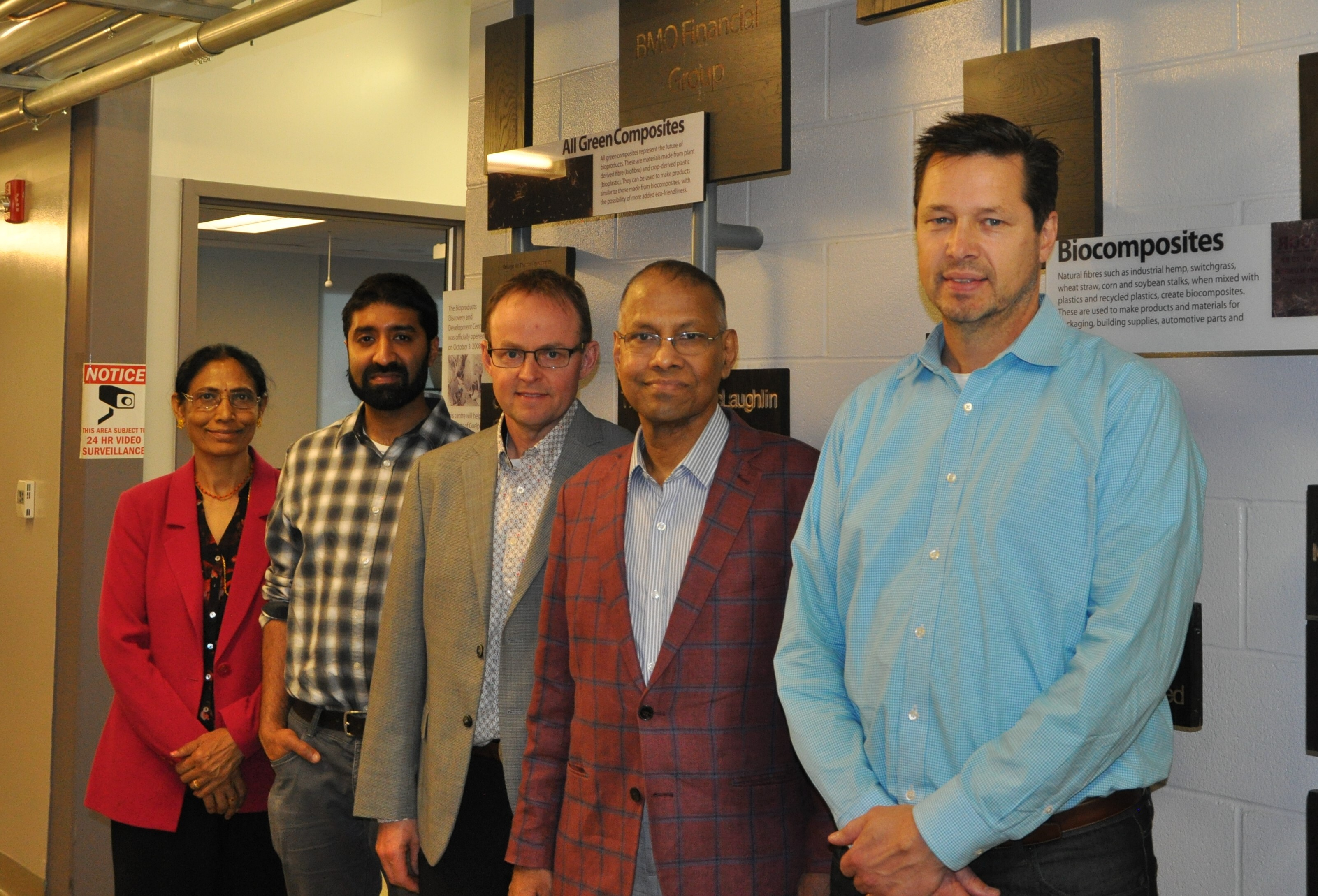 Image - Professors Amar Mohanty and Manjusri Misra with representatives from Ecosynthetix