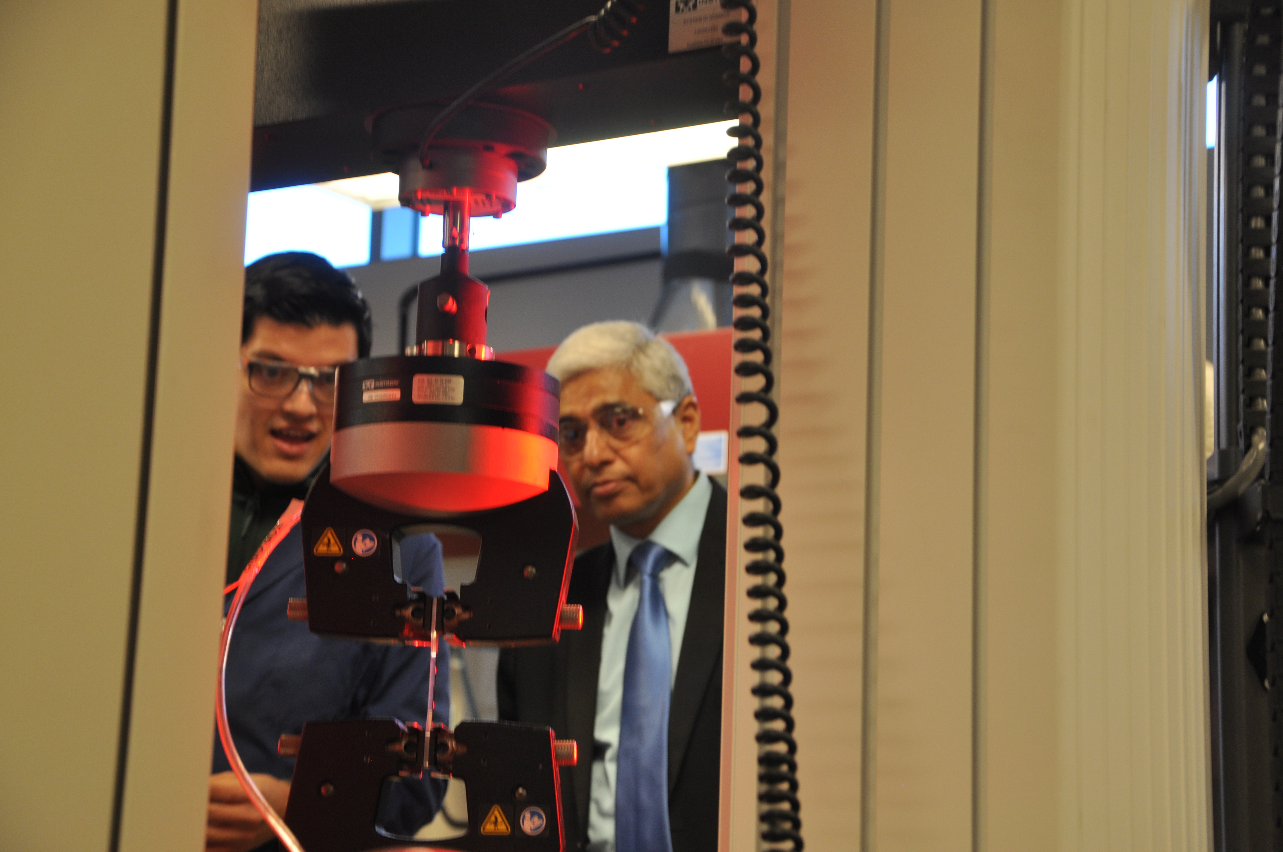 High Commissioner of India having equipment demonstrated to him.