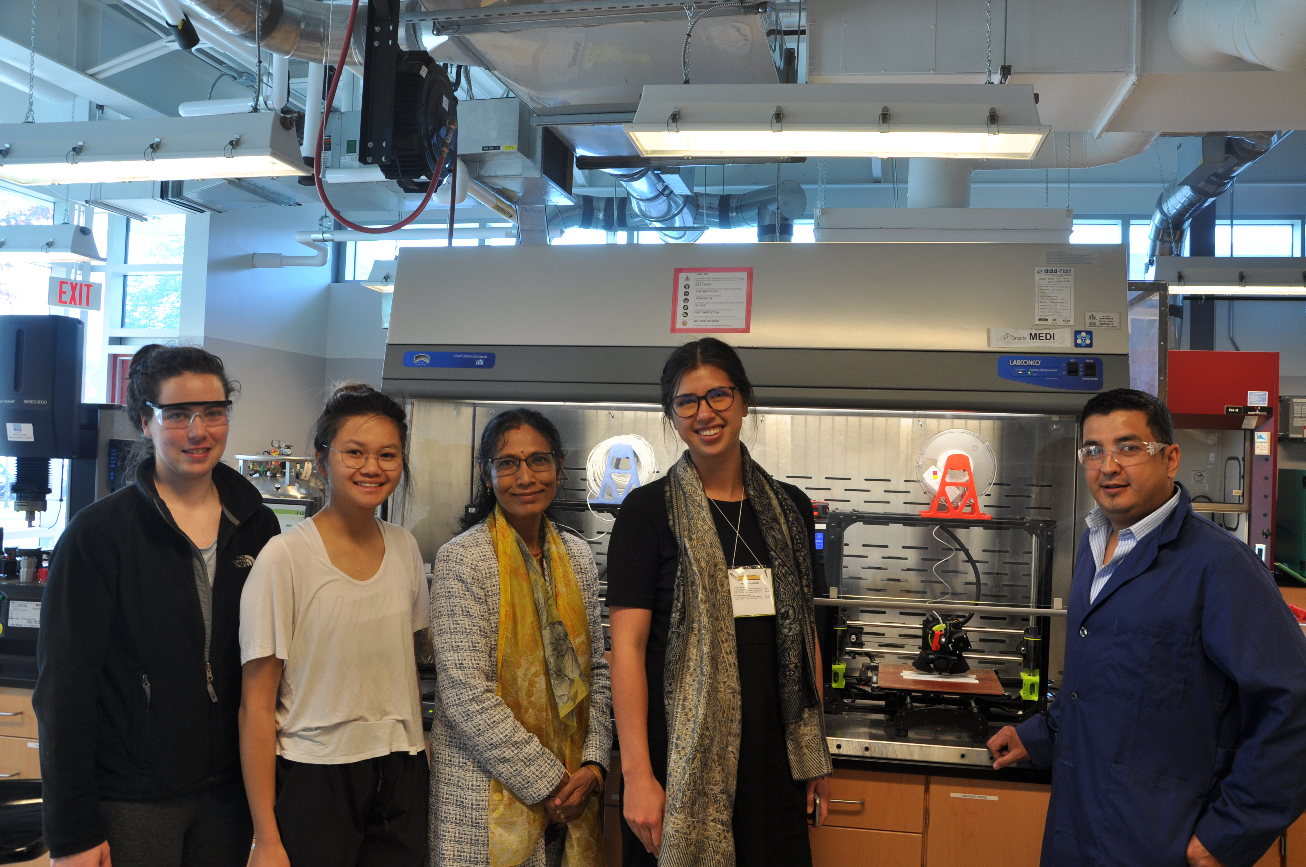 Emma Chow with BDDC Researchers in Front of the 3D Printers