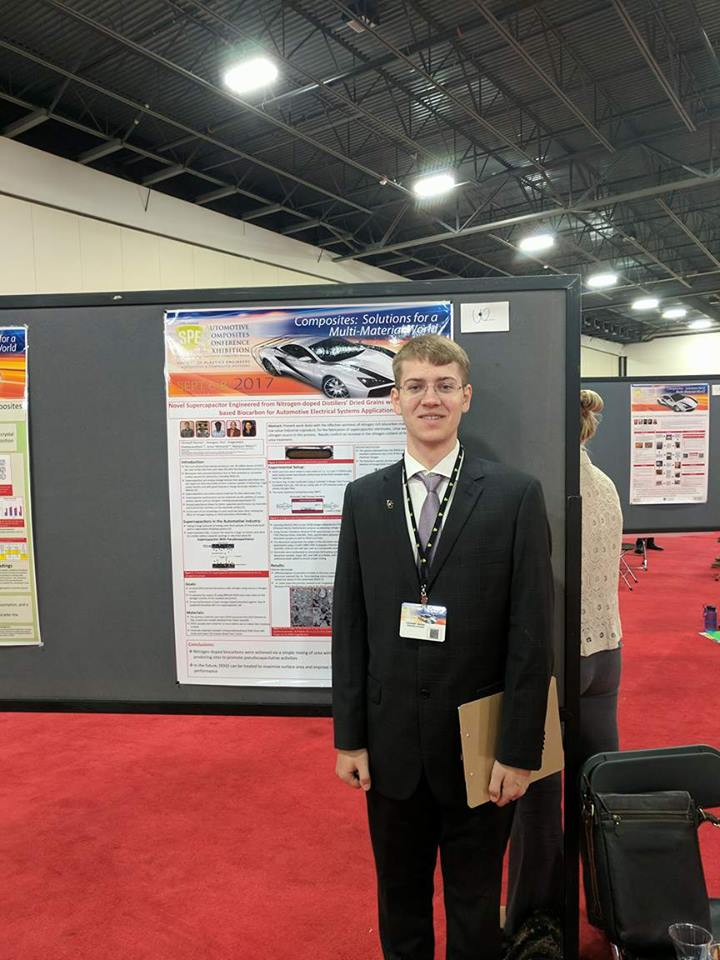 Christoff Reimer standing in front of his poster at SPE ACCE.